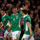 Republic of Ireland's Seamus Coleman celebrates scoring his side's first goal of the game with Republic of Ireland's James McCarthy (left) during the 2018 FIFA World Cup Qualifying match at the Aviva Stadium, Dublin. PA