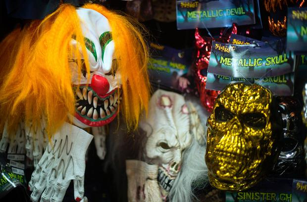 File photo taken on October 21, 2013 shows, Halloween masks on a wall at Spirit Halloween costume store in Easton, Maryland. AFP/Getty Images