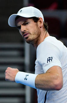 Andy Murray reacts after winning a point against Kyle Edmund
