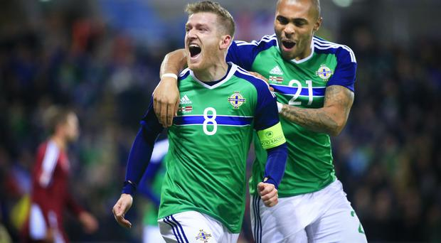 Northern Ireland's Steven Davis celebrates with Josh Magennis after scoring in action during the International friendly held at Windsor Park in Belfast. Pic Kevin Scott