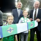 Press Eye - Northern Ireland - 7th October 2016 Northern Ireland v San Marino at the National Stadium, Belfast. Northern Ireland football stars Pat Jennings and Harry Gregg help Jay and Ellie cut the ribbon to official open the new stadium for the fans. Photographer - © Matt Mackey / Press Eye