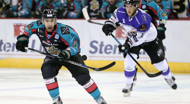 8 October 2016 - Picture by Darren Kidd / Press Eye. Challenge Cup: Stena Line Belfast Giants v Braehead Clan at the SSE Arena Belfast. Belfast Giants Stevie Saviano with Braehead Clan's Matt Haywood during Saturday nights Challenge Cup game at the SSE Arena, Belfast.