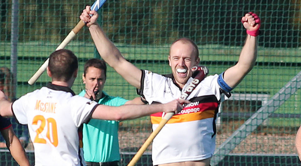 Talisman: Eugene Magee celebrates his goal which helped Bann qualify for European hockey's knock-out stages