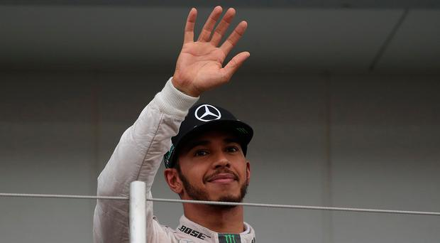 Left behind: Lewis Hamilton could only finish third after poor start