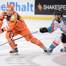 Giant slip-up: Steve Saviano of Belfast Giants closes in on Andreas Valdix