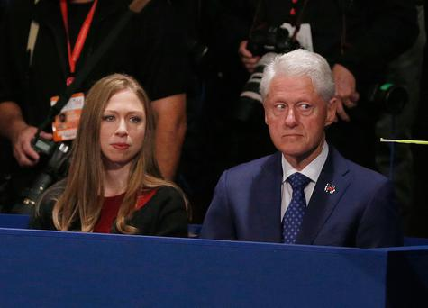 Chelsea Clinton, daughter of Hillary Clinton and former President Bill Clinton watch during the second presidential debate between Republican presidential nominee Donald Trump and Democratic presidential nominee Hillary Clinton at Washington University in St. Louis, Sunday, Oct. 9, 2016. (Jim Bourg/Pool via AP)