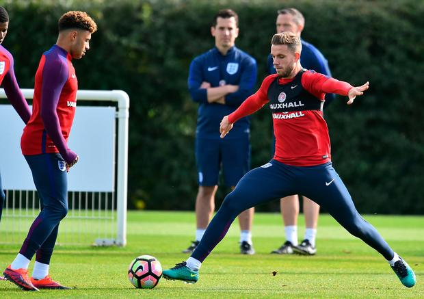 England's midfielder Alex Oxlade-Chamberlain (L) and England's midfielder Jordan Henderson attend a team training at Tottenham Hotspur's football training facility in Enfield, north London on October 10, 2016 on the eve of the team's World Cup qualifying match against Slovenia. /AFP/Getty Images
