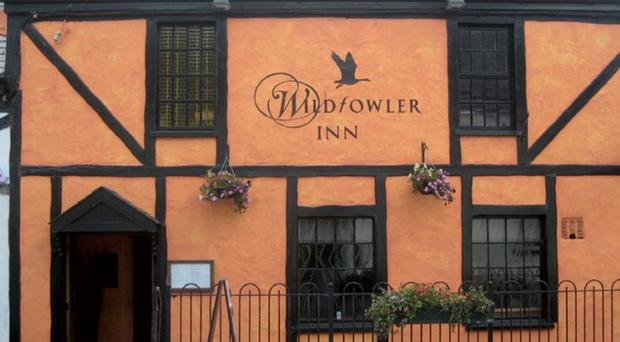 The ex-owners of the Wildfowler Inn have been banned from the boardroom