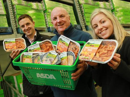 Brian Conway (centre), buying manager for Asda NI, with Mash Direct's Lance Hamilton and Clare Forster