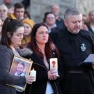 Widow Joanne McGibbon with her daughter Seana and Fr Gary Donegan