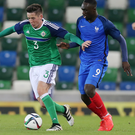 In control: Luke Conlan holds off France's Jean-Kevin Augustin