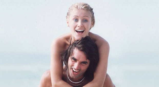 Life's a beach: George and Angie Best enjoy life in America