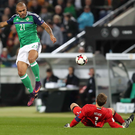 Chance: Josh Magennis is foiled by Michael Neuer during last night's World Cup qualifier in Hannover