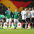 Pain game: Agony for Northern Ireland's bravehearts as the Germans celebrate in Hannover last night