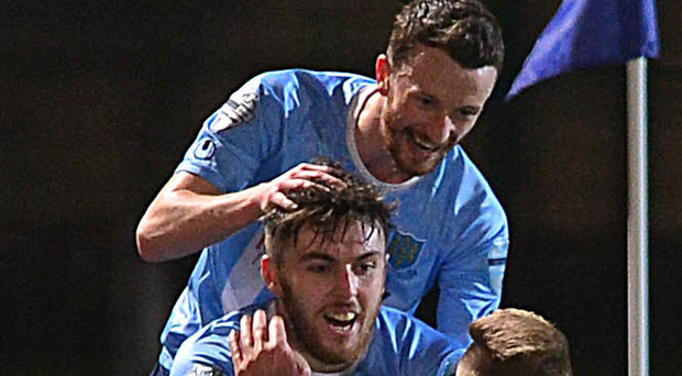 Get in: Cathair Friel is mobbed after his stunning goal for Ballymena against Linfield last night at the Showgrounds