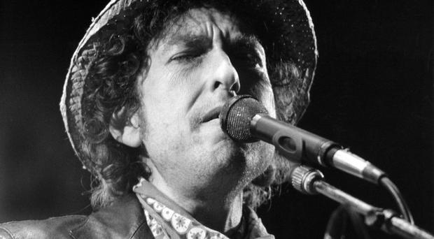 (FILES) This file photo taken on June 3, 1984 shows US singer Bob Dylan performing during a concert at the Olympic stadium in Munich, southern Germany. US songwriter Bob Dylan won the Nobel Literature Prize on October 13, 2016, the first songwriter to win the prestigious award and an announcement that surprised prize watchers. / AFP PHOTO / DPA / Istvan Bajzat / Germany OUTISTVAN BAJZAT/AFP/Getty Images