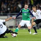 On the ball: Germany's Sami Khedira tackles Northern Ireland's Oliver Norwood during the World Cup qualifier in Hannover