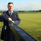 New surroundings: County Antrim chairman Collie Donnelly has a look around the new Dunsilly training complex, which features three full-size pitches and changing rooms