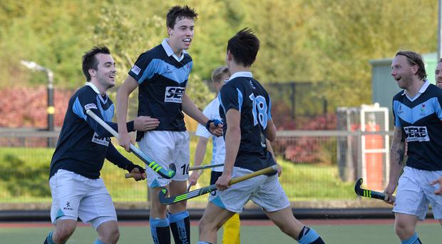 Last gasp: Lisnagarvey's Sean Murray celebrates his equaliser in the EY Irish Hockey League clash against Three Rock