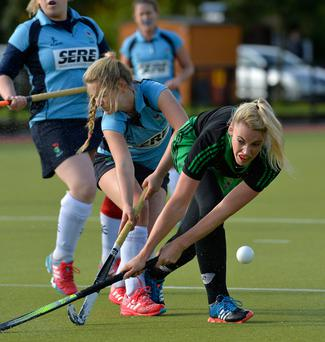 Up close: Garvey's Amy Brown (left) tussles with Niamh Sweeney of Trinity College during the Irish Senior Cup clash at Lisnagarvey