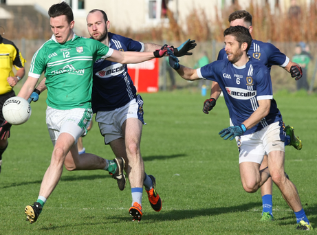 On the ball: Cargin's Paul McCann leads the charge against St Gall's in the Antrim final at Corrigan Park yesterday