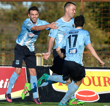 Drama: Kyle Owens leads the celebrations after Colin Coates' own goal earned Ballymena's win