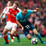Jostle: Shkodran Mustafi of Arsenal challenges Gylfi Sigurdsson