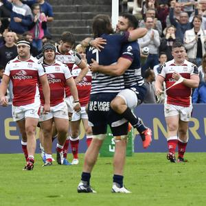 Bad blow: Bordeaux players celebrate as the disconsolate Ulster team trudge off the pitch after their late defeat