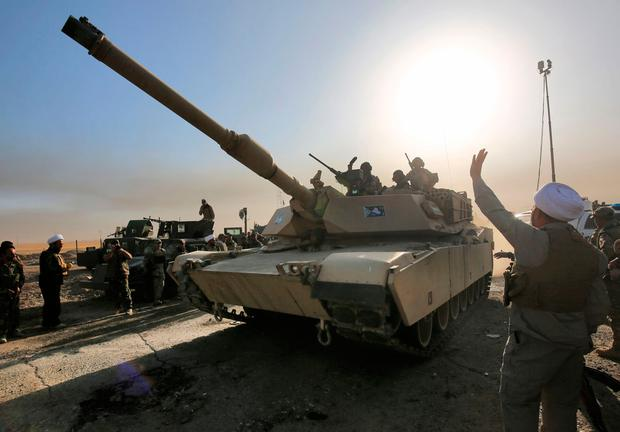 Iraqi forces deploy in the area of al-Shourah, some 45 kms south of Mosul, as they advance towards the city to retake it from the Islamic State (IS) group jihadists, on October 17, 2016. AFP/Getty Images