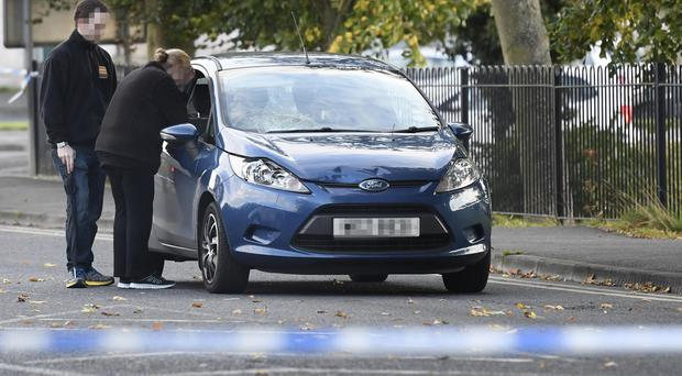 Police on the Scarva Road in Banbridge after tTwo children have been knocked down on Monday afternoon. Photo: Colm Lenaghan/Pacemaker