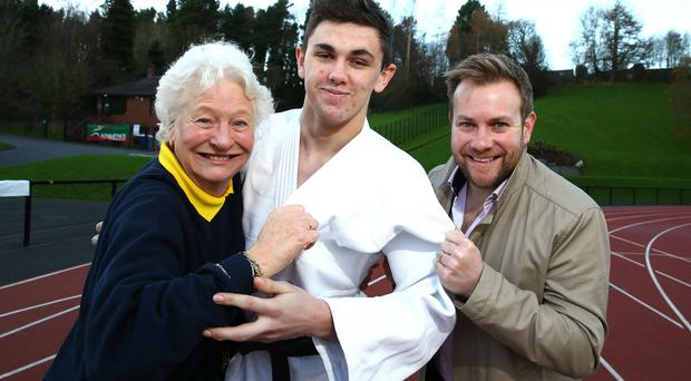 Getting to grips: Dame Mary Peters, James Reid and Rainbow's Stuart Carson