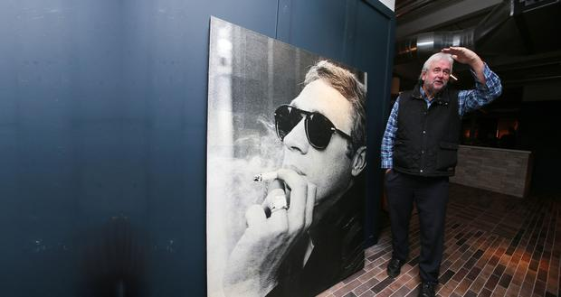 Journalist Ivan Little with the Steve McQueen portrait hanging once again at the Bullitt hotel in Belfast