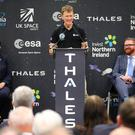 Principia Mission Astronaut Tim Peake speaks to Thales employees as First Minister Arlene Foster and Economy Minister Simon Hamilton look on. Photo by Kelvin Boyes / Press Eye