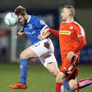 Cliftonville's Jude Winchester with Linfield's Jamie Mulgrew during Tuesday nights Danske Bank Premiership game at Solitude. Photo by William Cherry/Presseye