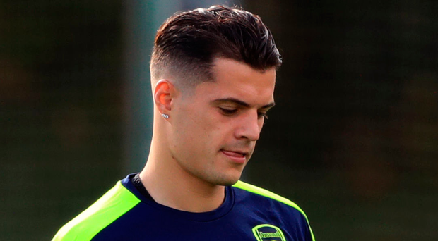 Streak: Granit Xhaka has had eight reds since April 2014. Photo: John Walton/PA