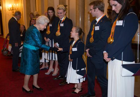 The Queen meets athletes including Bethany Firth from Seaforde during a reception for Team GB and Paralympics GB medallists at Buckingham Palace