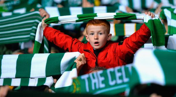 GLASGOW, SCOTLAND - OCTOBER 19: A Celtic fan sings during the UEFA Champions League group C match between Celtic FC and VfL Borussia Moenchengladbach at Celtic Park on October 19, 2016 in Glasgow, Scotland. (Photo by Mark Runnacles/Getty Images)