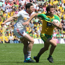 Showpiece occasion: Tyrone's Sean Cavanagh tries to get to grips with Donegal's Conor Clarke in the Ulster Final in Clones in July, the Red Hands triumphing to advance to the All-Ireland quarter-final stage
