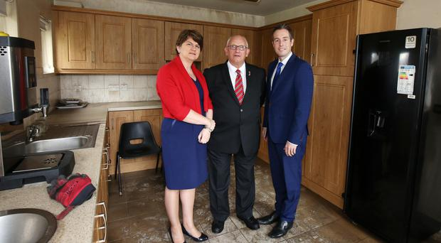 First Minister Arlene Foster, Billy Thompson of the Orange Community Network and Communities Minister Paul Givan at the funding announcement yesterday