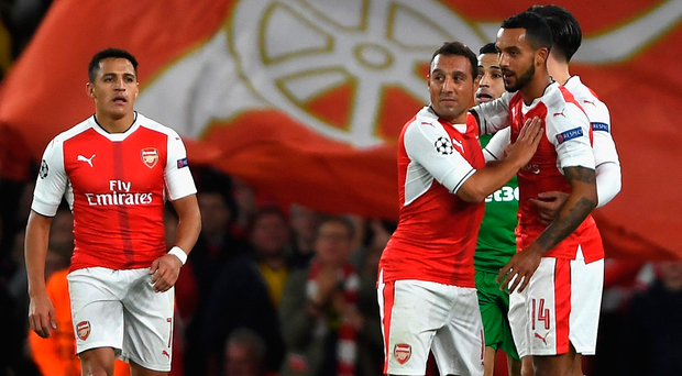 Six appeal: Theo Walcott is hailed after scoring in the 6-0 victory