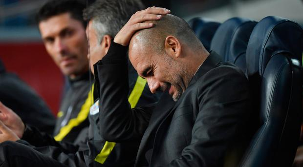 All going wrong: Pep Guardiola shows his pain after the false nine tactic he used during his Barca days badly flops