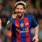 Hat stuff: Lionel Messi celebrates his three-goal demolition of Man City