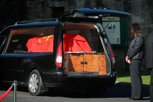 Anthony Foley's wife Olive looks at the coffin of her husband as its brought to repose in St. Flannan's Church, Killaloe in Co Clare, ahead off his funeral tomorrow. PA