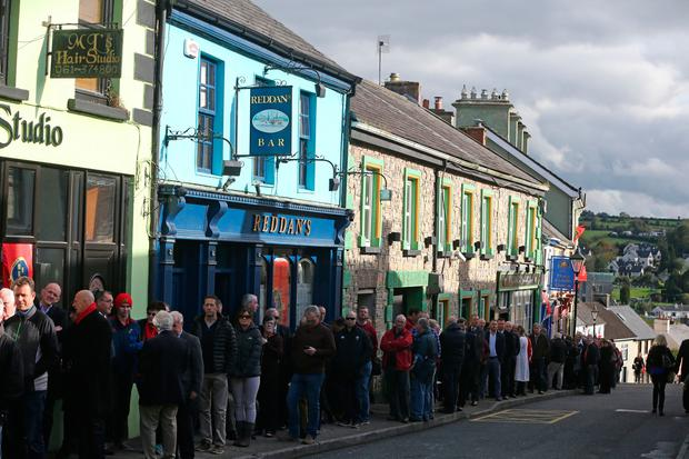 People wait in line to view the coffin of Munster Rugby head coach Anthony Foley in repose in St. Flannan's Church, Killaloe in Co Clare, ahead off his funeral tomorrow. PA