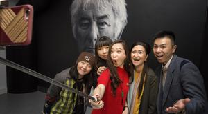 Chinese bloggers Shujin Wang, Bo Liu, Yan Ma, Aileen O'Neill, Tourism NI and Pu Zang are pictured taking a selfie in front of Seamus Heaney's portrait. Picture by Brian Morrison.
