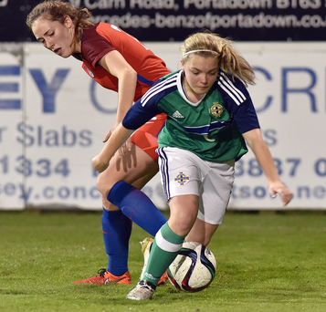 Making ground: Northern Ireland's Lauren Robson battles with Lucy Parker in the Under-19 international at Shamrock Park