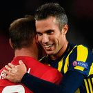Old pals: Wayne Rooney and Robin van Persie at end of last night's game