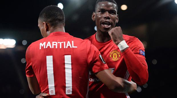 Different class: Anthony Martial (left) and Paul Pogba celebrate the win over Fenerbache