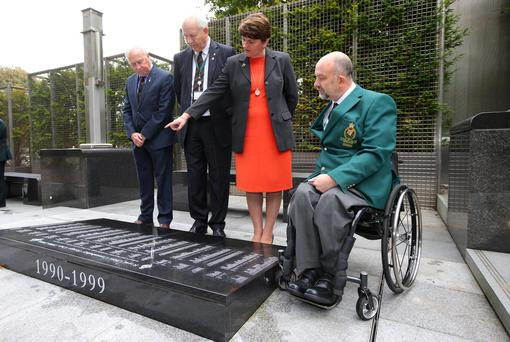 First Minister Arlene Foster with chairman Brian Rea, trustee Stephen White and guide Michael Wilson during a visit to the RUC George Cross Foundation Memorial Garden in east Belfast