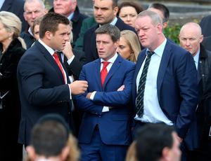 Munster's CJ Stander (left) alongside former Munster players Ronan O'Gara (centre) and Mick Galwey awaits the arrival of the hearse at St Flannan's Church, Killaloe, Co. Clare.